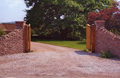 driveway, gateposts and wooden gates